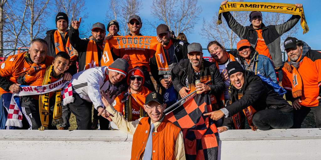 Forge FC co-founder Bob Young celebrates with travelling fans at ATCO Field. (Photo: CPL)