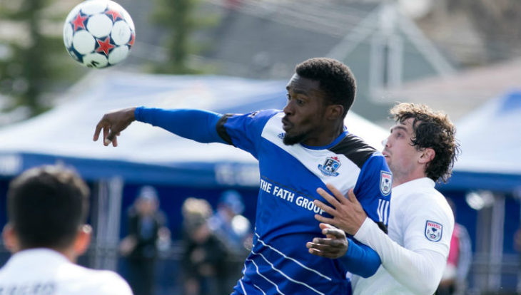 Ameobi goes up for a header during his first stint with FC Edmonton