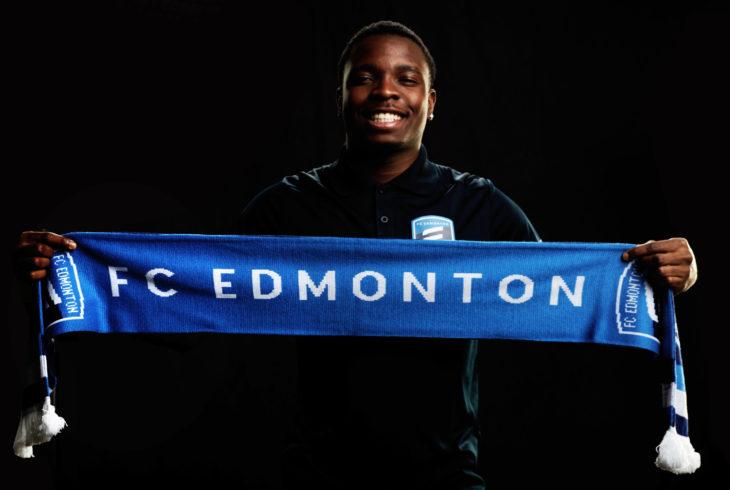Doe proudly holding an FC Edmonton scarf