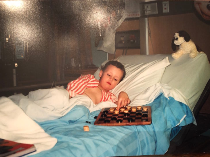 A young Dylon Powley playing checkers while at the Stollery Hospital.