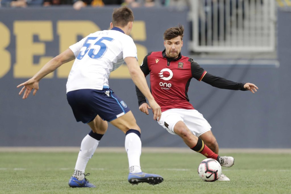 May 4, 2019; Winnipeg, Manitoba, CAN; FC Edmonton defender Amer Didic (55) blocks a kick by Valour FC midfielder Michael Petrasso (9) in the second half during a Canadian Premier League soccer match at Investors Group Field. Mandatory Credit: James Carey Lauder-USA TODAY Sports for CPL