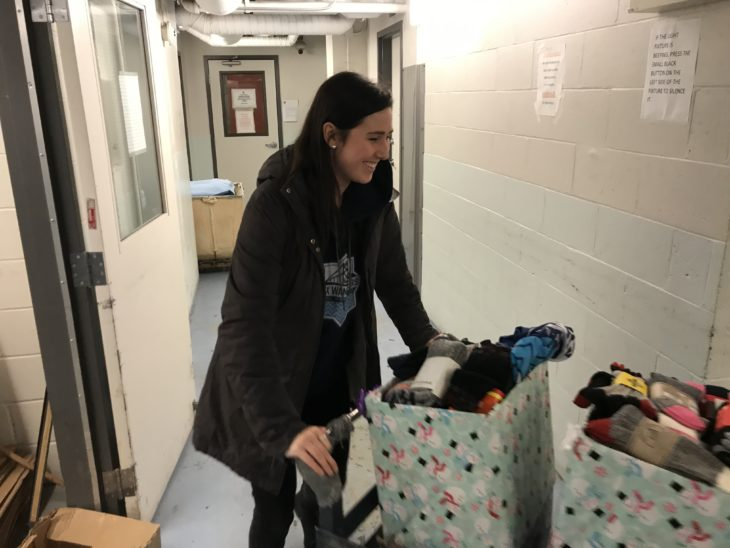 Wanderers Danae Iatrou delivering 200 pairs of socks to the Salvation Army.