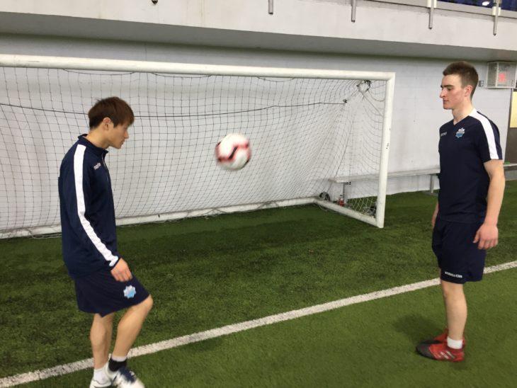 Scott Firth sharpening his ball juggling skills with Koda Iida.