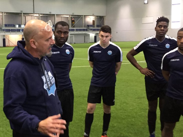 Christian Oxner taking in instructions from coach Stephen Hart during preseason training.