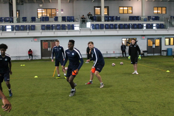 André Bona and Peter Schaale chasing down the ball in a keep away drill in training.