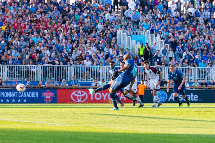 Luis Alberto Perea slots home a penalty kick in front of a sea of blue from the  Wanderers Grounds stand. Photo: Trevor MacMillan.