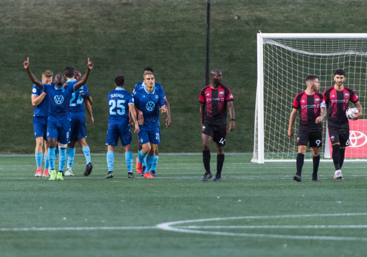 Chrisnovic N'sa points to the sky to celebrate a Wanderers goal in Ottawa. Photo: Steve Kingsman/Freestyle Photography for Ottawa Fury FC.