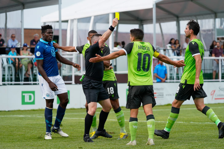 André Bona (shown after being fouled at York9) said the road trip has been difficult but the players are keen to reward the fans with a good showing in Edmonton. Photo: York9 FC.