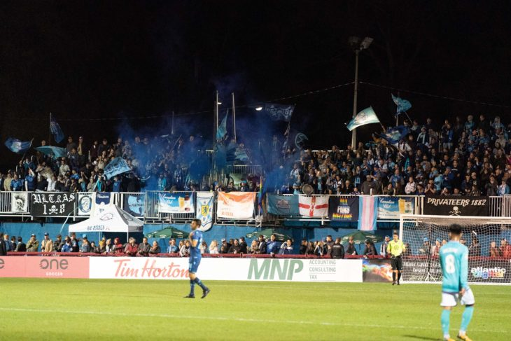 The signature blue smoke at the last Wanderers home match this season against Pacific, Oct 9. Photo: Scott Tanner.