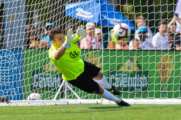 One of the highlights of Christian Oxner's debut season was this penalty kick save against Cavalry's Dominique Malonga. Photo: Trevor MacMillan.