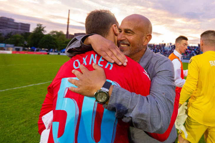 Oxner shares a hug with coach Stephen Hart after shutting out Valour and leading the Wanderers to a 2-0 home win in June. Photo: Trevor MacMillan.