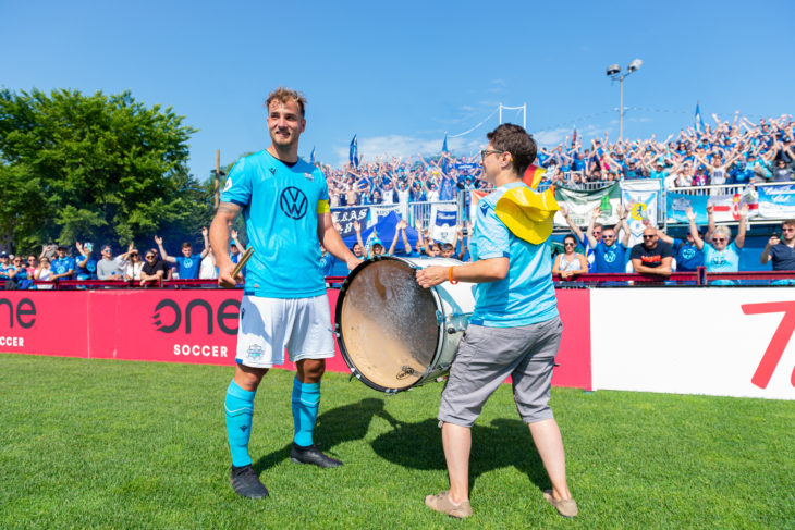 The Wanderers centre-back drumming with Lynne Fox at his send off. Photo: Trevor MacMillan.