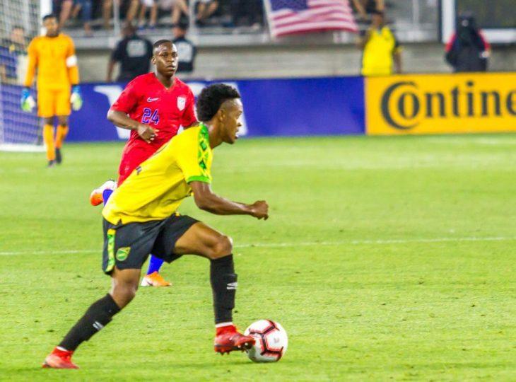 Alex Marshall on the ball for Jamaica. Photo: Jamaican Football Federation.