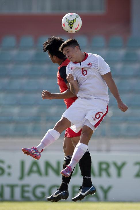Aparicio gets his head on the ball for Canada