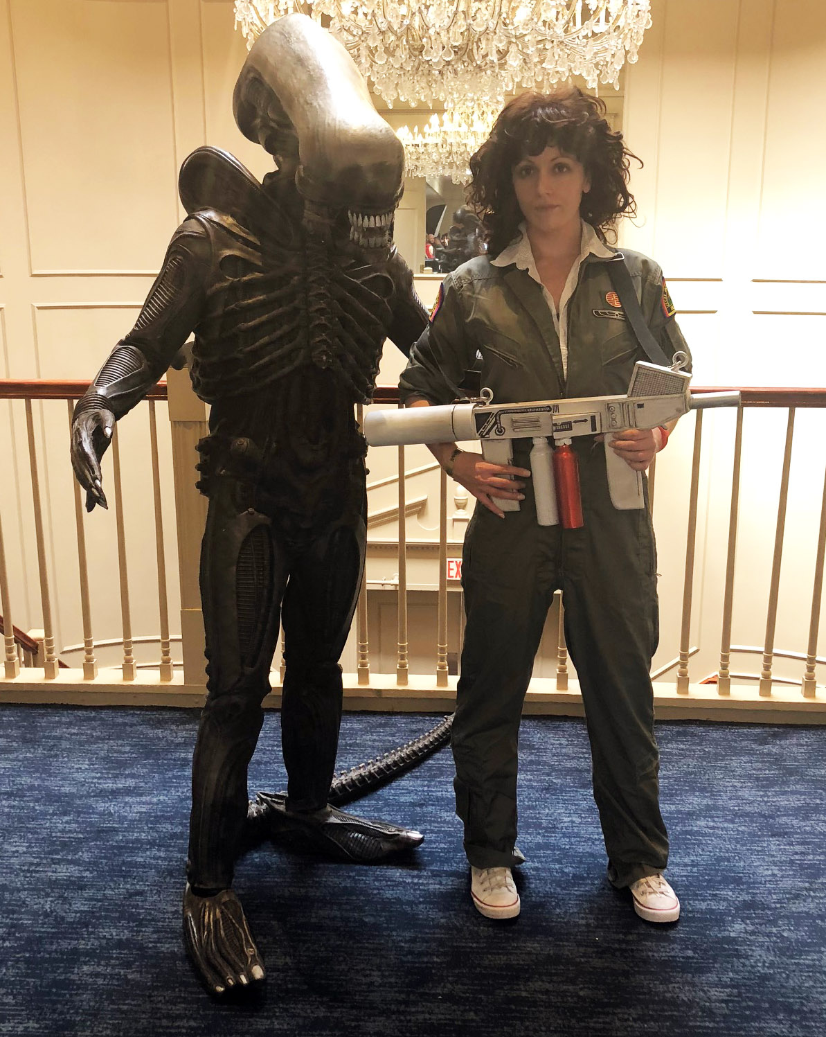 "Two people dressed as a xenomorph and Ripley from the movie ""Alien"""