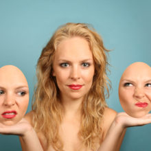 woman holding two faces - double-minded