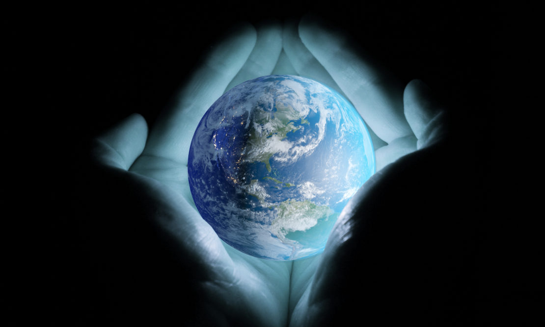 kingdom of God - God holding earth in His hands