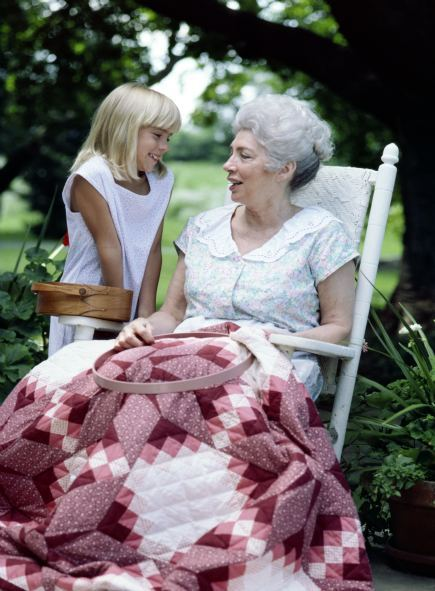 woman quilting in rocking chair