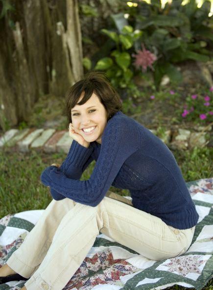 woman sitting on handmade quilt