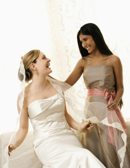 bridesmaid and bride give gift