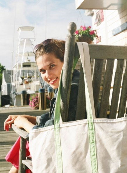 woman holds diy tote bag