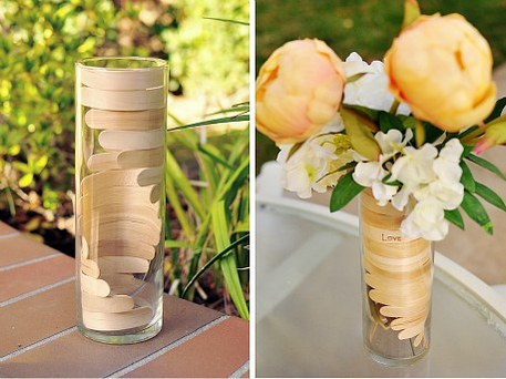 bent popsicle sticks decorate a vase