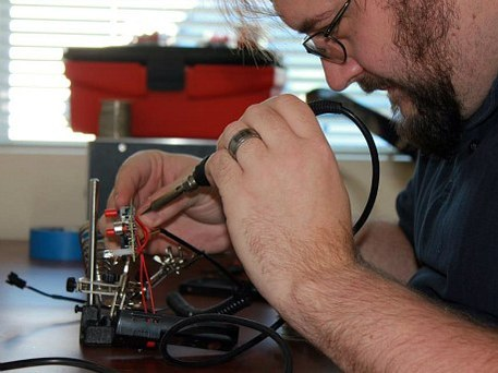 man builds tech at craft workroom
