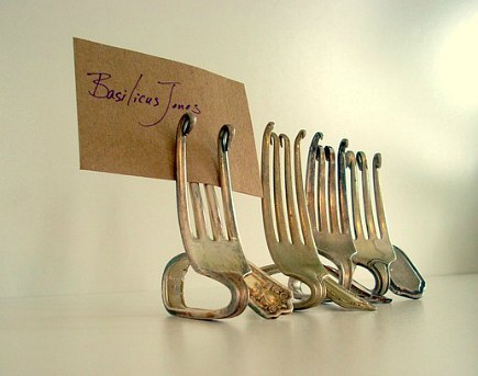 bent silver fork card holders