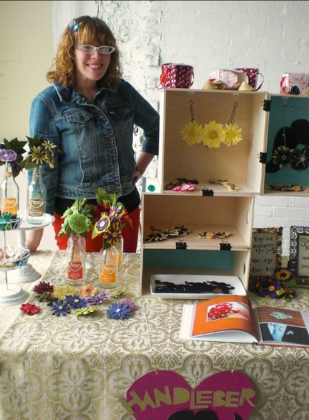 woman selling at a craft fair