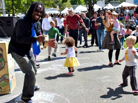 Dancing children and adults savoring the art at the Folklife Festival