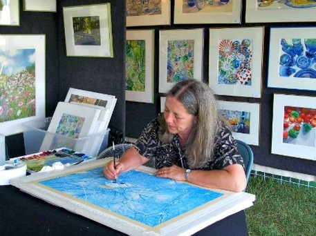 A woman painting at Mountain Heritage Arts and Crafts Festival