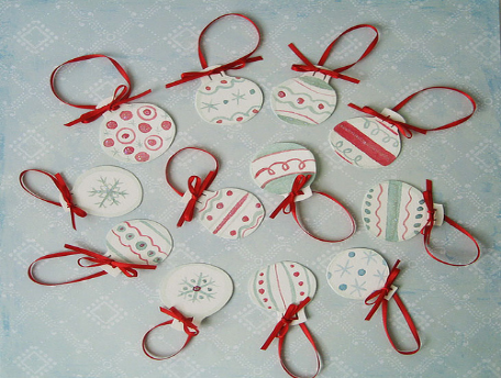 Small, circular Christmas ornaments made from paper
