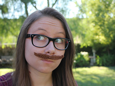 woman wears crochet mustache