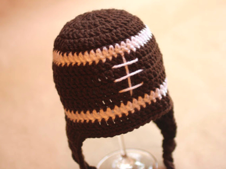 Crochet games with this free football crochet hat pattern