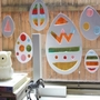 Homemade stained glass Easter eggs on a window