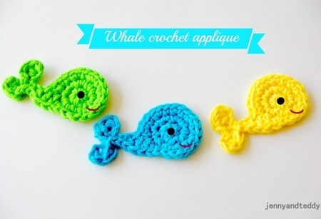 Three crochet whales in different colors