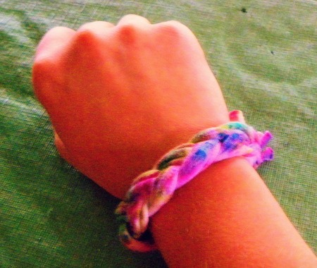 A tie-dyed, cloth bracelet