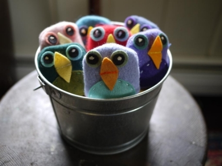 Little bean bag birds made from fabric and felt in a silver bucket