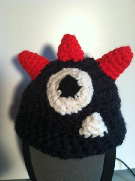 A hat for a child with a monster eye on it