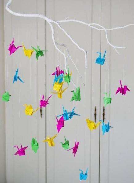 A baby mobile made from colorful paper cranes