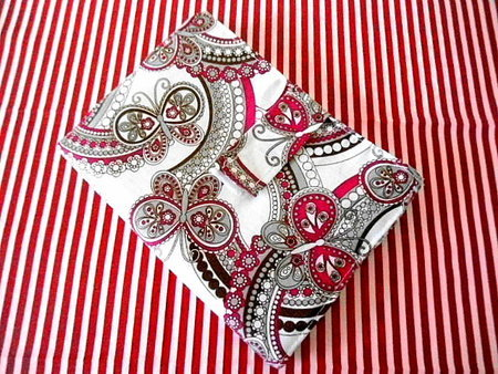 A red and white paisley e-reader cover