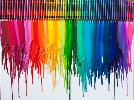Melted crayons on a white poster