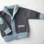 A blue and gray, grampa-style cardigan for babies