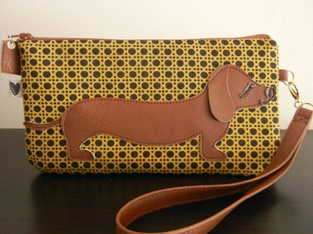 A homemade yellow handbag with a dachsund on the front