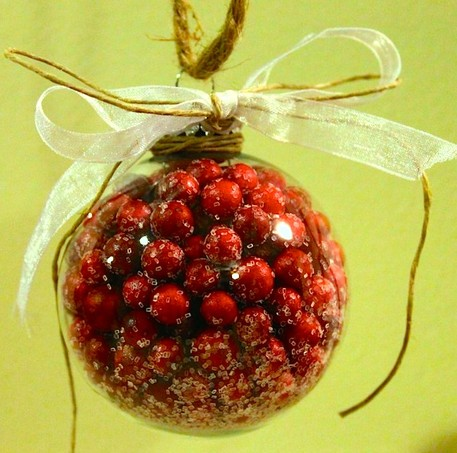 cranberry filled glass ornament