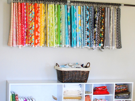 hanging fabric over storage shelves