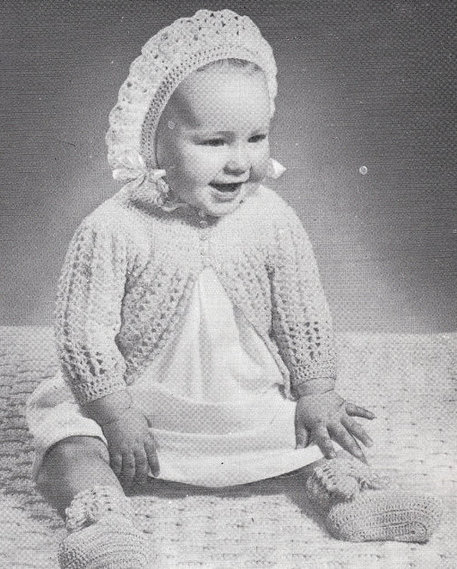 Photo of Baby Wearing Vintage Bonnet, Sweater and Booties