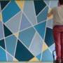 painting an accent wall using tape to create a design