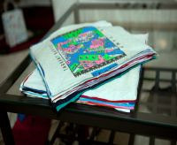 stack of cut T-shirts for t-shirt scrapbook quilt