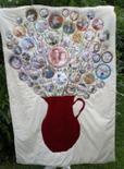 a scrapbook quilt made from photos and an applique jug
